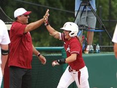 Alabama's Haylie McCleney (8) and Alabama coach Patrick Murphy high-five as McCleney (8) rounds third base after hitting home run in the top of the second inning during a game against Washington in the NCAA Regional Tournament held at Rhoads Stadium in Tuscaloosa, Ala. on Sunday May 17, 2015. Alabama won the game 11-1 and will host the Super Regional Tournament May 21-24…
