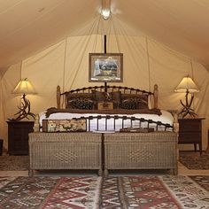 """Tent camping redefined: Feather beds. Forget the air mattress. There'll be no sore necks after a night on """"The last best bed"""" in the luxury tent from The Resort at Paws Up."""
