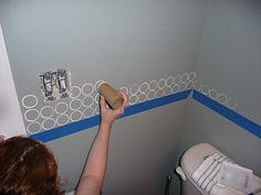 Paint Circles Onto The Wall With Toilet Paper Tube