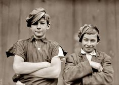 November 1909. Two of the boys on night shift in the More-Jones Glass Co., Bridgeton, New Jersey. Photograph by Lewis Wickes Hine. Seem to be having a playful moment. Love the side-tilted hats... some things never change about kids. lol