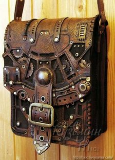 """geekygeekweek: """" Stunning Steampunk Leather Bags And Books These bags and books are the work of Russian leatherworker and throat singer Serguei Kooc. He's created incredibly detailed Steampunk bags and books with lots of brass accents. Costume Steampunk, Viktorianischer Steampunk, Design Steampunk, Steampunk Couture, Steampunk Clothing, Steampunk Fashion, Gothic Fashion, Steampunk Outfits, Steampunk Necklace"""