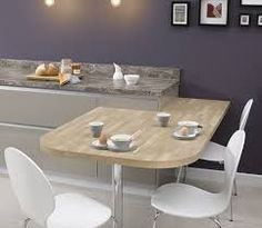 Image result for white work tops with wooden circular  breakfast bar grey kitchen