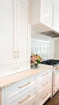 i like the white cabinet with a slight off white countertop color
