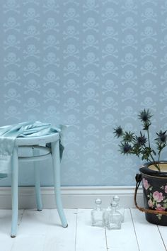 Unexpected skeleton pattern on a powder blue wall covering