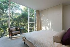 This upstairs bedroom benefits for mature trees that filter natural light. Photo: Peter Lyons Photography