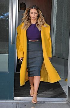 Kim Kardashian's Max Mara coat announced her presence when she hit the street outside her apartment.