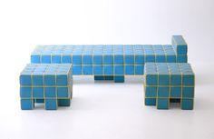 Kim HyunJoo a conçu le sofa « Grid Sofa and Stool » pour le Groupe SK à l'Expo Yeosu 2012 en Corée. Il s'aventure sur une ligne et un style complètement moderne, en instaurant sur le classique sofa en cuir estampé, un quadrillage et du tissu (sacrilège).