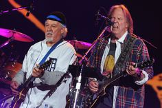 Frank 'Poncho' Sampedro and Neil Young of Neil Young and Crazy Horse perform in New York City.