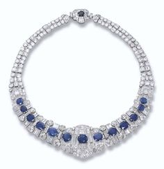 PROPERTY OF A ROYAL HOUSE: A SAPPHIRE AND DIAMOND NECKLACE The front designed as thirteen graduated oval-shaped and circular-cut sapphires to the pavé-set and baguette-cut diamond central panel and flexible circular and baguette-cut diamond sides and back.