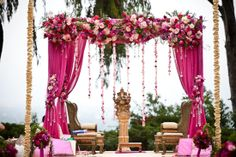 outdoor indian wedding. love the draping w/ flowers!You can experiment maybe a different color though...#MandapDecor