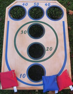 bean bag toss ....    I NEED this for our backyard.