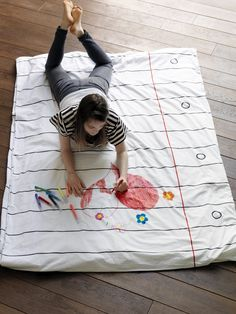 """Doodle duvet is printed to look like a giant piece of file paper, complete with printed holes, lines and red margins on both sides. And it comes with its own pack of 8 wash-out doodle colour pens so that you can make it individual - endlessly!"" - My boy child would LOVE this!"