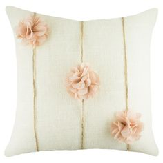handmade burlap pillow, showcasing twine and floral accents.