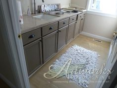 Coco Chalk Paint™ on laundry room cabinets. #artworksspokane, #anniesloanunfolded