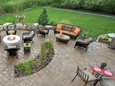 After a fire burned the home to the ground, a Minnesota family rebuilt their home and worked with Southview Design to redo the landscaping. The new patio has Belgard Urbana pavers in various patterns, including an area cut out for plants. The natural stone boulders around the fire pit are made of Fond du Lac limestone.