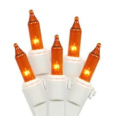 "#trendy 100 Light #Amber Mini Light Set on white wire. 22 gauge wire. Clips on each bulb to help hold them in place. 4"" spacing between the bulbs. 33' lighted le..."