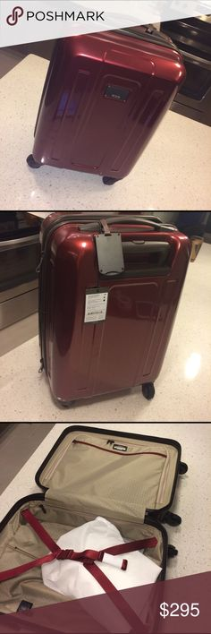 NWT TUMI carry-on GOEGEOUS red TUMI carry on - new with tags it's like a burgundy red color Tumi Bags Travel Bags
