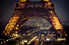 The Eiffel Tower at night with lights all around | Murray Mitchell