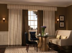 Layered pinch pleat drapes add drama and elegance to this classic living room.
