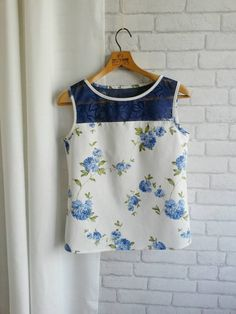 Check out this item in my Etsy shop https://www.etsy.com/listing/289065819/sleeveless-shirt-blue-lace-top-white