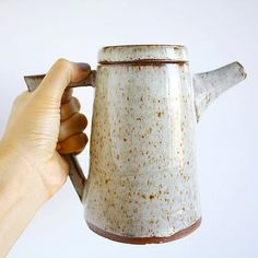 Handmade ceramic tea pot with matching cups