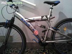 . Hola vendo una bici para montana con suspensi�n adelante y atr�s de color plata y azul  precio45e
