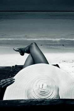 A large sun hat is essential beach wear and perfect shade for a holiday read.... I LOVE MY SUN HAT