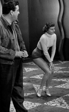 1953 - Jackie Gleason is watching dancer Louise Ferrand perform her 2 different numbers.  Gleason Girls series.