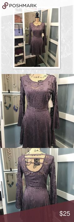 New Altar'd State dress NWT purple/plum bell sleeve dress. Built in slip/ cami. Side zip.  Back has  leaf trim going across. Measures approx: 35 inches from the top of the shoulder  and 14.5 inches flat in the waist. Altar'd State Dresses Midi