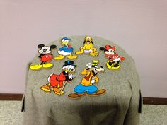 Six wooden Disney figures: Mickey Mouse, Minnie Mouse, Pluto, Donald Duck, Uncle Scrooge and  Goofy