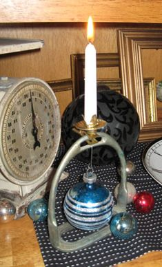 """""""Talk about simple, I found these stirrups at a recent estate sale. I simiply hung a vintage ornament from them, and cliped on one of those old candle clips, on top. What a great way to highlight a special ornament. You could add some Christmas greenery or ribbon if you want, but I liked them sweet and simple."""" -- on robojunker.com"""