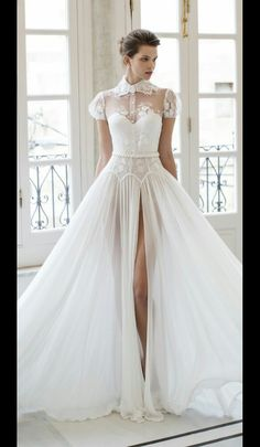 The top is what wearing the top of my Mom's wedding dress as an overlay/jacket would look like