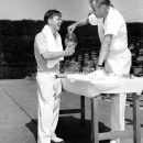 Mickey Rooney and former tennis champ Bill Tilden rest between sets at the Ambassador Hotel court Los Angeles. February, 1941