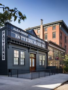 Exterior, Metal Roof Material, and House Building Type The building's historical facade was preserved, and the original company sign was retained. Jersey City, New Jersey, Building Exterior, Brick Building, Building A House, Michael Graves, Building Signs, Timber Structure, Brick And Mortar