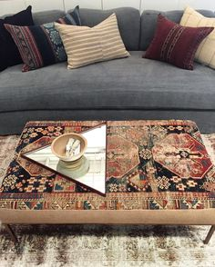 Gorgeous ottoman, couch and pillows by Amber Interiors