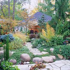 Include Hardscape: Incorporate large stones and boulders into the landscape to create an instant sense of permanence and age. Bury a portion of some stones to achieve a more natural look as you position the boulders in a grouping.