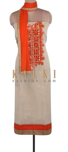 Buy Online from the link below. We ship worldwide (Free Shipping over US$100). Product SKU - 305886. Product Link - http://www.kalkifashion.com/beige-unstitched-suit-adorn-in-mirror-and-resham-embroidery-only-on-kalki.html