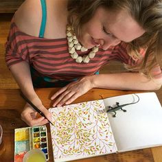 Painting at Vicinity this morning with @kari.pearson ! It's a beautiful day! (Thanks, Kari, for snapping this picture of me.) #Illustratorinminneapolis #watercolor #painting #patterns #makingitupasigo #handbookwatercolorjournal #illustration #leavesandberries