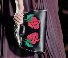 With classic American automobile inspired imagery and details appearing on their leather handbags, shoes, eyewear and many of their textiles, the new collection has gotten engines running. (Prada)