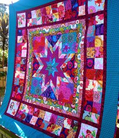 'Star Jewels' pattern by Chasing Cottons is a great quilt to use up your fabric stash or going with a specific fabric range. This quilt is sewn with Kaffe Fasset & Anna Maria Horner fabric. Just beautiful!
