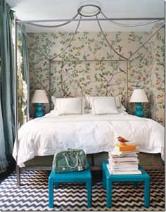 Bedroom with bird wallpaper and chevron rug; design by Miles Redd; featured in Domino Magazine