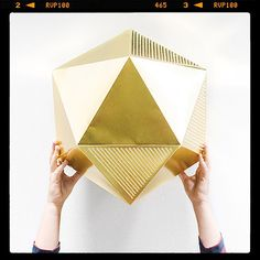 Golden icosahedron by @Marsha Golemac - part of her week in pictures on the Temple & Webster blog.  http://blog.templeandwebster.com.au/marsha-golemac-my-week-in-pictures/ #paper art
