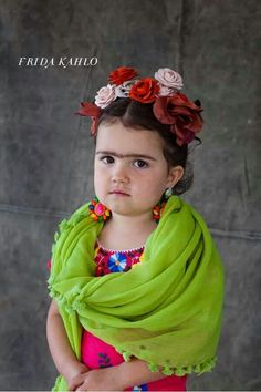 Frida costume... oh my, this girl is darling, but you can tell she is pissed!