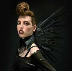 Roadkill Couture: A feather collar.
