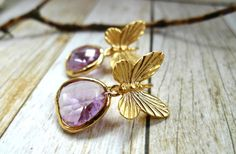 Items similar to Gold Plated Butterfly Drop Earrings with a Light Purple Glass Charm on Etsy Purple Glass, Light Purple, Butterfly, Stud Earrings, Charmed, Jewellery, Trending Outfits, Unique Jewelry, Handmade Gifts