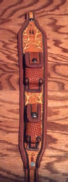 Handcrafted leather rifle sling, this would also make a great wall hanging. The pockets could hold a deck of cards, a set of dice, or just pencils/pens and a small pad of paper.