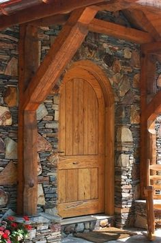 .Beautiful arched wood door in stone.