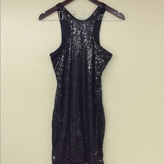 gone 7/30!! The perfect little black dress! Sequin racer front dress. Measurements (flat): neck (racerfront)= 4.5 inches wide; chest=14 inches; length =33.5 inches Dresses Mini