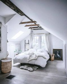 Such a pretty bedroom! We love the added natural elements like the wooden night stand, ladder, and the exposed beams. They contrast well against the white!