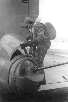 Luftwaffe tail gunner getting into the Heinkel He 177 for a bombing mission.